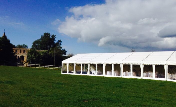 White marquee for an outdoor wedding