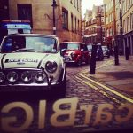 Mini coopers in a London street.