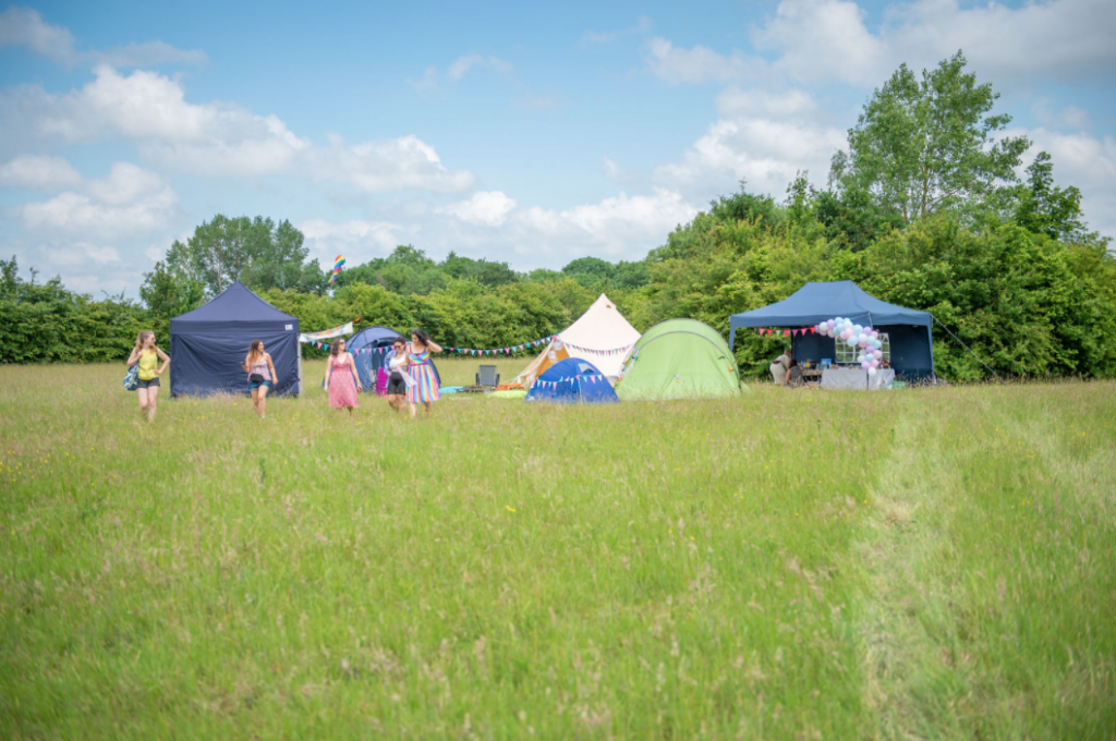 Private festival for a hen party weekend in a field.