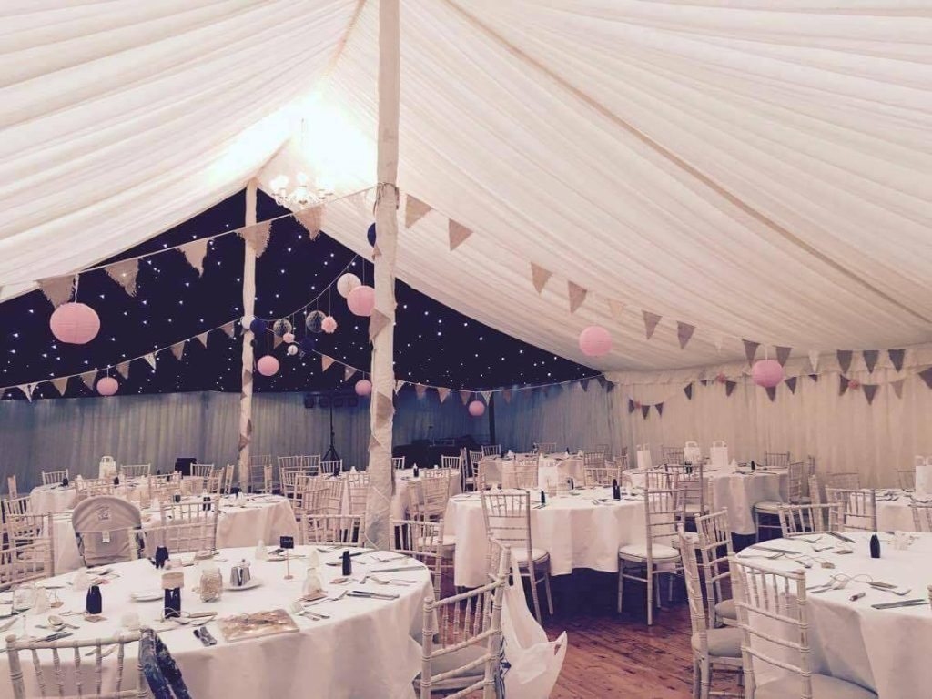 bunting in a tent dressed for a wedding